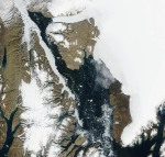 Nares Strait between northern Greenland and Canada on Aug.-13, 2005 with Petermann and Humbold Glaciers at top and center right from MODIS imagery using red, blue, and green channels.