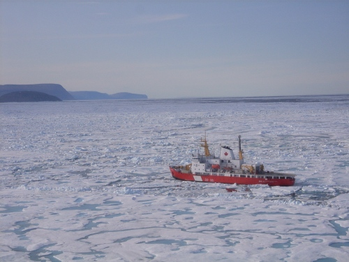 CCGS Henry Larsen in thick and multi-year ice of Nares Strait in August 2009. View is to the south with Greenland in the background. [Photo Credit: Dr. Helen Johnson]