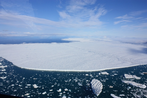 Petermann Ice Island of 2012 at the entrance of Petermann Fjord. The view is to the north-west with Ellesmere Island, Canada in the background. [Photo Credit: Jonathan Poole, CCGS Henry Larsen]
