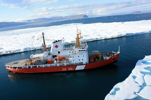 CCGS Henry Larsen at the entrance to Petermann Fjord in August 2012 adjacent to the 2012 Petermann Ice Island. [Photo Credit: Jon Poole and Canadian Coast Guard Ship Henry Larsen]