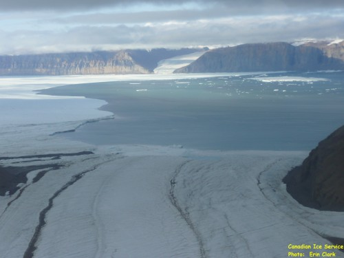 Seaward front of Petermann Glacier Aug.-11, 2012. View is from a small side-glacier towards the south-east across Petermann Fjord with Petermann Gletscher to the left (east). [Photo Credit: Erin Clarke, Canadian Coast Guard Ship Henry Larsen]