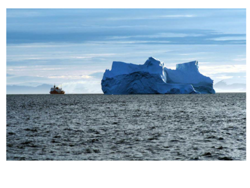 USCGC Healy in northern Baffin Bay in July 2003 with iceberg. Ellesmere Island is in the background.