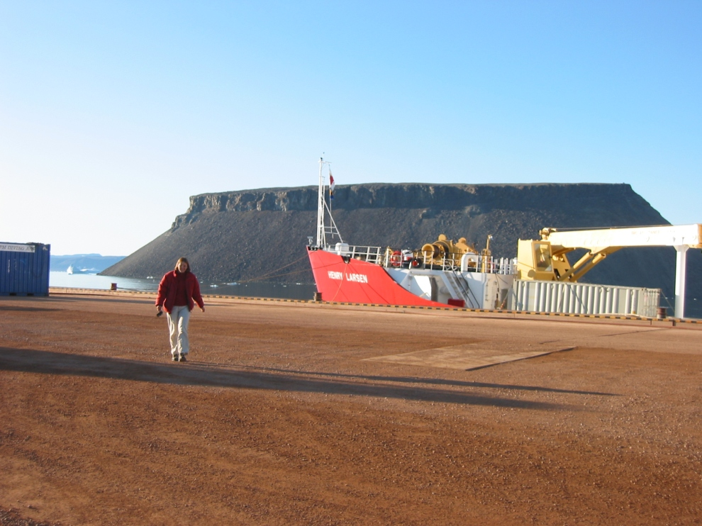 Dr. Helen Johnson in August 2009 on the pier of Thule AFB with CCGS Henry Larsen and Dundas Mountain in the background. [Credit: Andreas Muenchow]