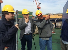 Axel Meiton, Alan Mix, and Chris Moser consulting on the set-up of sediment core processing on I/B Oden in June 2015.