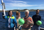 Happy scientists on a small outing in a Swedish fjord after testing oceanographic equipment.