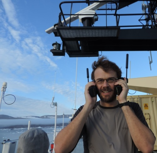 Rob Holden testing Iridium phones above the bridge of I/B Oden.