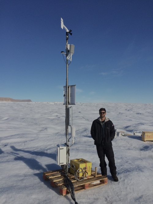University of Delaware PhD student Peter Washam at the Ocean-Weather station on Petermann Gletscher after final installation 2015-Aug.-20, 17:00 UTC at 80 39.9697 N and 60 29.7135 W.
