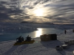 Midnight sun at ice drilling camp on Petermann Gletscher 20 August 2015. Notice central channel. [Credit: Peter Washam]
