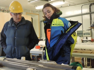 Drs. Alan Mix and Kelly Hogan discussing the first-ever ocean sediment cores from below a glacier in Greenland in Aug.-2015.
