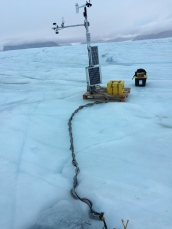 Cabled ocean observatory linked to a University of Delaware weather station on Petermann Gletscher, Greenland on 28 August 2016. View is to the north.