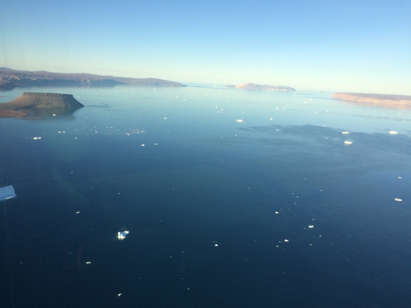 Wolstenholme Fjord on Aug.-27, 2016. The view to the west with Mount Dundas on the left (south) and southern part of Saunders Island on the right (north).