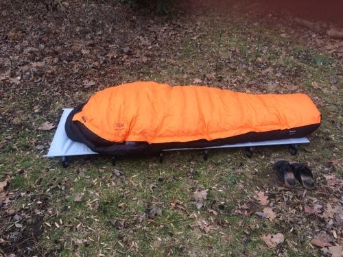 Cot, air mattress, and down sleeping bag testing in my garden after a rough night.