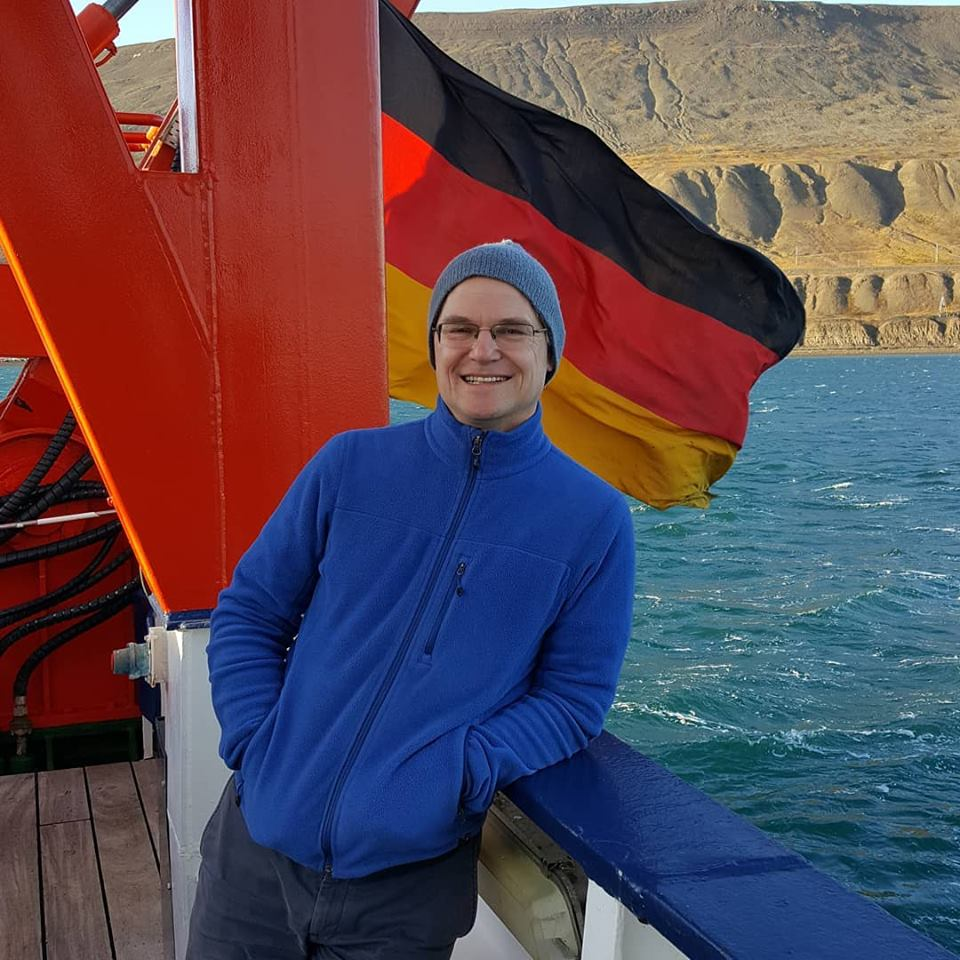 Author aboard German research vessel F/S Maria S. Merian in port of Longyearbyen, Svalbard in the fall of 2018. [Photo by Dragonfly Leathrum.]