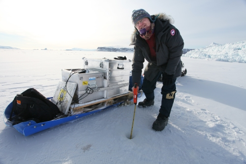 The author measuring sea ice thickness in Wolstenholme Fjord, Greenland April-17, 2017.