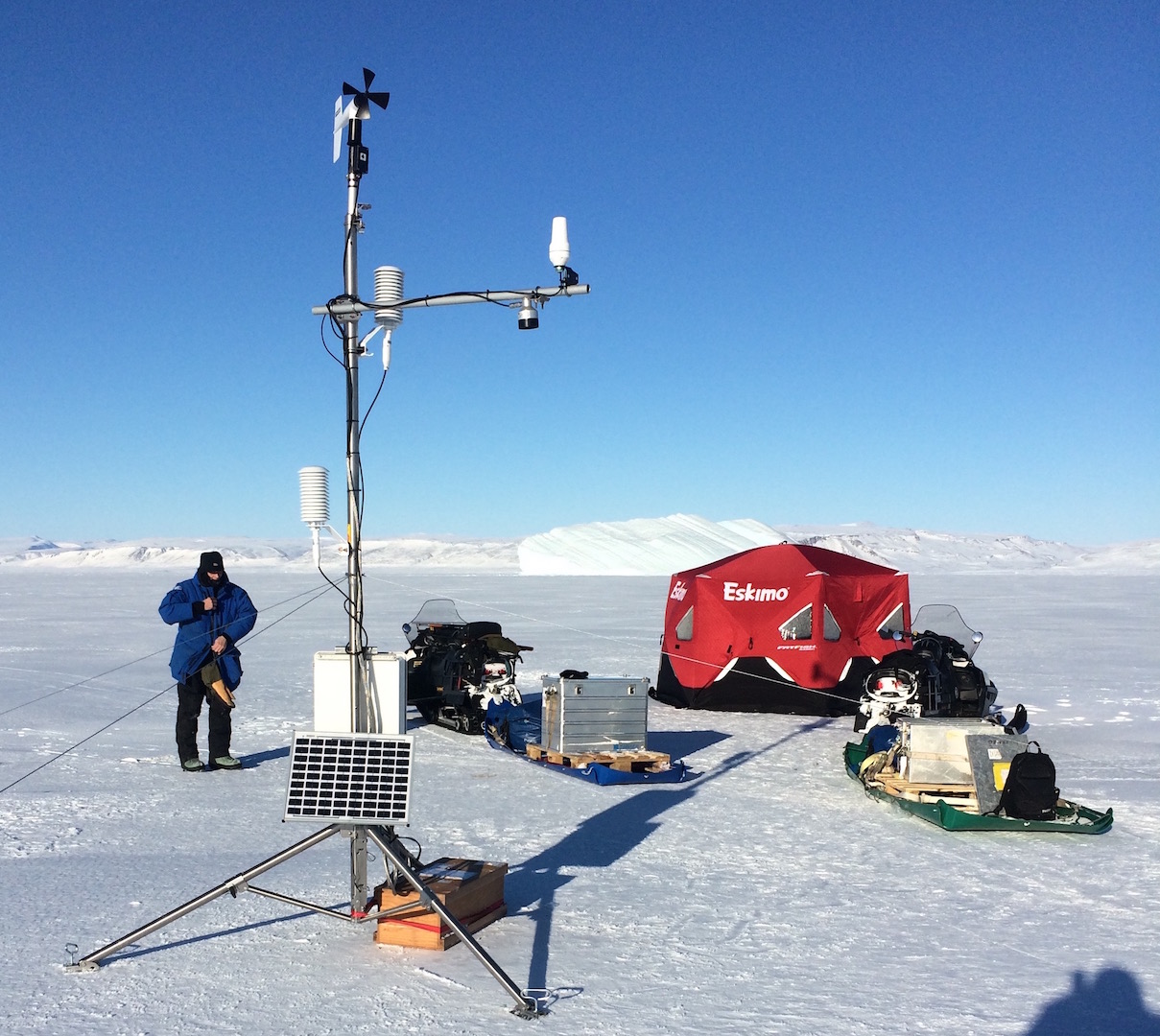 Installation of Automated Weather Station on Mar.-23, 2017 near Thule, Greenland via snowmobile. The station includes a satellite connection to the internet and a cable to the ocean.