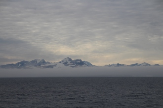 Marine layer at the entrance of Scoresby Sund on Aug.-20, 2018. Photo by Dragonfly Leathrum]