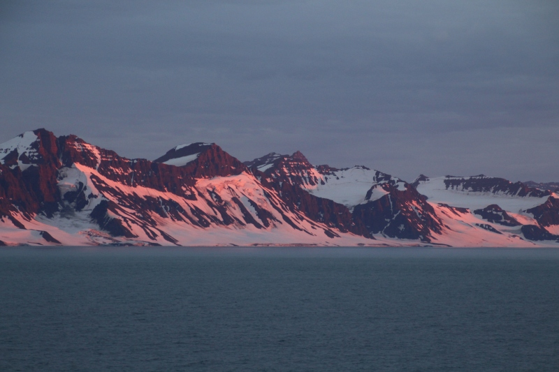 Evening sun on mountains on the Volquart Boons Kyst in Scoresby Sund on August 20, 2018. [Photo by Dragonfly Leathrum]